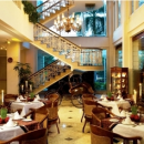 restaurant in hotel lobby with staircase