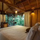anavilhanas hotel room bed with windows and terrace over jungle