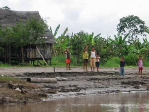 local children on the banks of the river