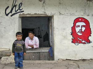 locals next to che painting