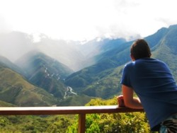 customer overlooking mountain range