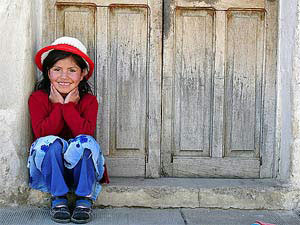 local girl sitting on step