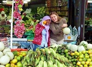 Borneo customer and local woman at market fruit stall