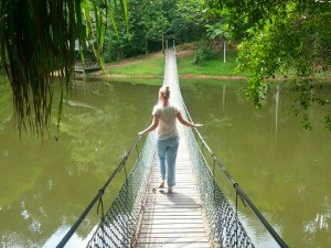 Girl walking on rope bridge