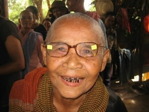 old woman wearing glasses and smiling