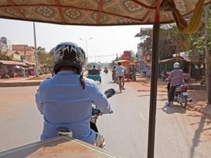 View of street from the back of a tuk tuk in Cambodia