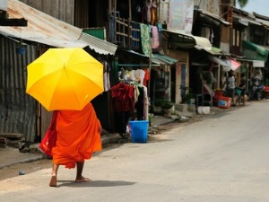 Monk walking with umbrella in Cambodia