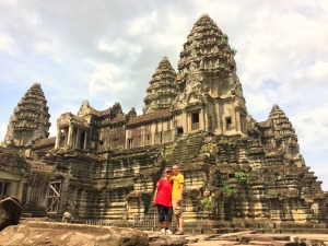 A couple posing in front of a Cambodian temple