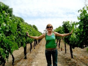Travel specialist Ceri standing in vineyards