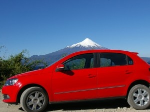 Car parked with mountain scenery background