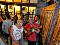woman smiling with local musician in cuba