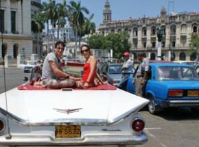 customers in classic car in Havana