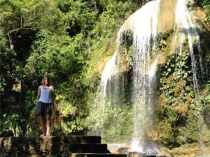 Woman standing in front of a waterfall in Las Terrazas in Cuba