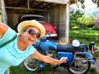 customer smiling in front of motorbike in cuba