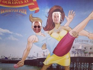 Rickshaw Rambler couple visiting Brighton and posing in a comedy photo booth on Brighton Pier