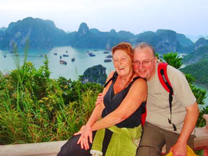 Rickshaw customers smiling while overlooking Halong Bay Vietnam at a viewpoint
