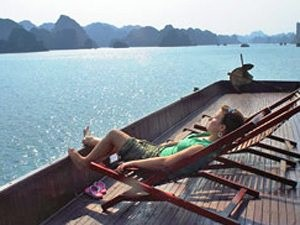 Halong bay customer relaxing by water
