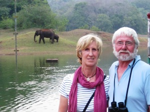 India customers by lake with elephant in background