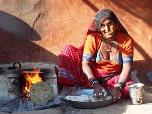 India local woman cooking over fire