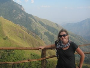 woman on top of munnar mountain in Kerala India