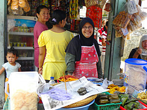 Local woman on market stall
