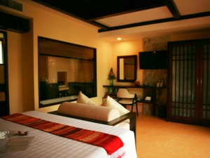 Ko samui hotel room with bed and sitting area