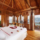 Thailand island wooden bungalow with bed covered in flowers