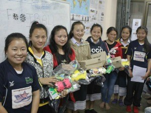 Children smiling at local project in Laos