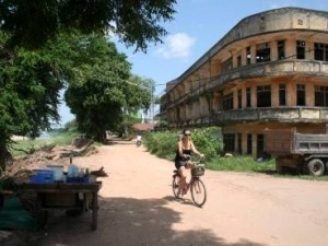 woman riding a bike in laos