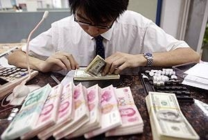 Malaysia man counting local currency
