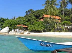 Boat moored up on a sandy beach in the Perhentian Islands Malaysia