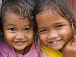 Close up of two young smiling Malaysian girls