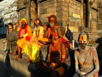 local hoply men in orange and yellow clothing nepal