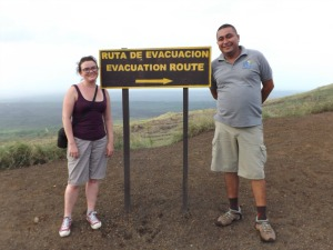 woman and guide with evacuation sign