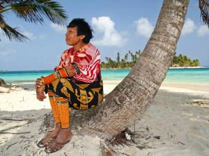 local man sitting on a palm tree