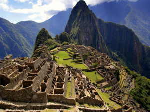 view overlooking ancient ruins of machu picchu on mountain top in peru