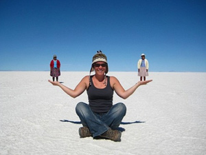 Woman sitting on the Uyuni salt flats in Bolivia