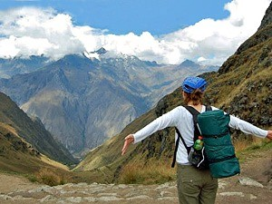 woman overlooking mountain viewpoint in peru