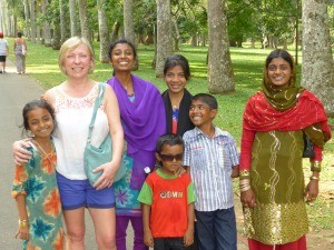 Rickshaw customer standing with a group of local Sri Lankans