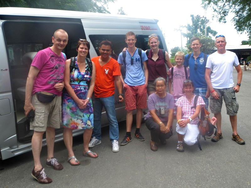 group standing in front of tour van in thailand