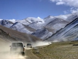 Car driving through the mountains in Tibet