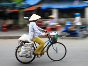 Ho Chi Minh local woman on bicycle