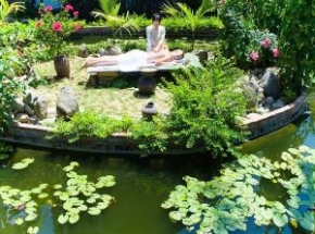 Vietnam massage in garden with pond