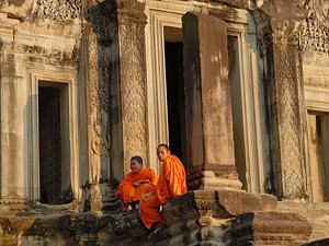 Vietnam monks outsude stone temple