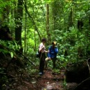 Jennifer with guide walking in the jungle