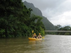 Kayak Between Limestone Peaks