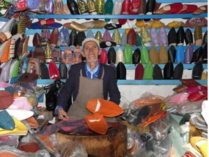 man with shoes in souk