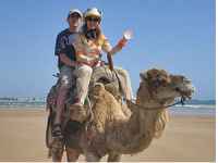 couple on camel ride on the beach in Essaouira Morocco
