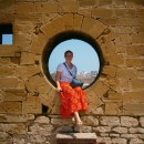 Rickshaw Travel Specialist Fiona sitting in a hole in a brick wall in Essaouira Morocco