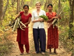local women in jungle with a traveller in Nepal